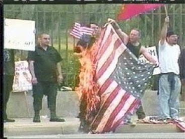 Illegal Immigrants Burning Our Flag In Front of the Veterans Cemetary