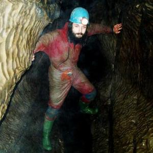 Caveman Tunnel Digger With Blue Hard Hat