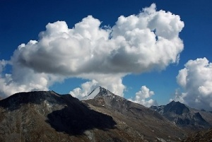 Cloud Suspended Above Snow Caldera
