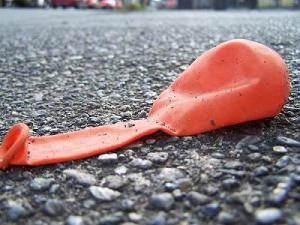 Deflated Balloon on Asphalt