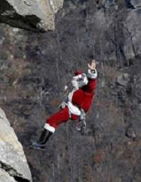 Santa Rappelling At Chimney Rock