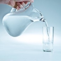 Pitcher of Water Being Poured
