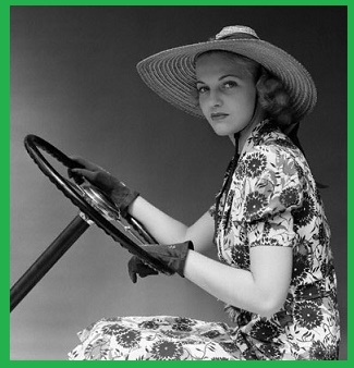 Woman Driving With Gloves and Straw Sunhat