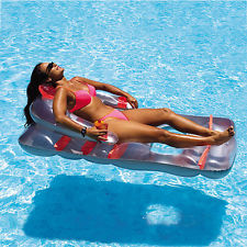 Woman Floating on a Pool Raft
