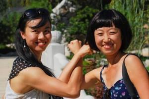 Two Asian Women Doing An Alternate Fist Bump